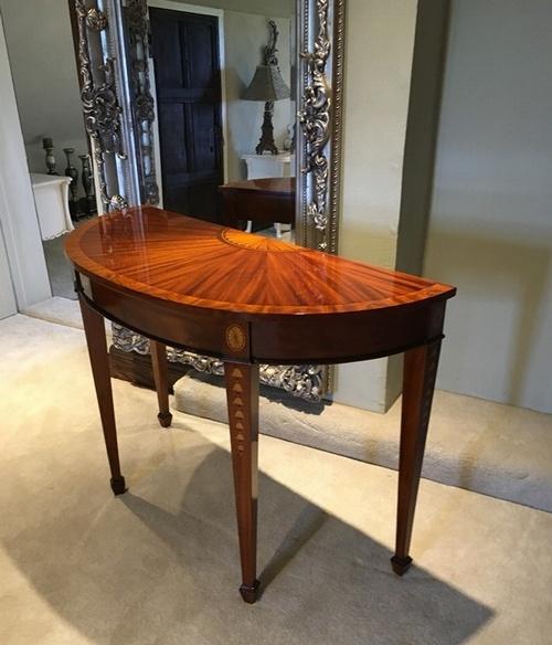 the half moon burl console table