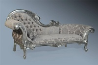 The Flower Carved Chaise Longue: Antique Silver Leaf & Grey Damask
